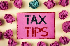 Writing note showing Tax Tips. Business photo showcasing Help Ideas for taxation Increasing Earnings Reduction on expenses Concept. Writing note showing  Tax Stock Photo