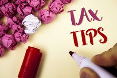 Writing note showing Tax Tips. Business photo showcasing Help Ideas for taxation Increasing Earnings Reduction on expenses Concept. Writing note showing Tax Tips royalty free stock photo
