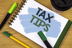 Writing note showing Tax Tips. Business photo showcasing Help Ideas for taxation Increasing Earnings Reduction on expenses Concept. Writing note showing Tax Tips stock photography