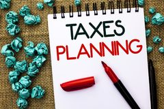 Writing note showing  Taxes Planning. Business photo showcasing Financial Planification Taxation Business Payments Prepared writte. N Notebook Book the jute Royalty Free Stock Photo