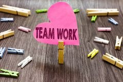 Writing note showing Team Work. Business photo showcasing Combined action of a group Workgroup cooperation collaboration. Clothespin holding pink paper heart stock photo