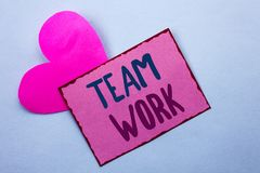 Writing note showing Team Work. Business photo showcasing Cooperation Together Group Work Achievement Unity Collaboration written. Pink Sticky Note Paper the stock image