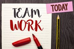 Writing note showing Team Work. Business photo showcasing Cooperation Together Group Work Achievement Unity Collaboration written. Notebook Paper the Wooden royalty free stock photo