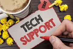 Writing note showing  Tech Support. Business photo showcasing Help given by technician Online or Call Center Customer Service writ. Ten Man Holding Marker Stock Photography