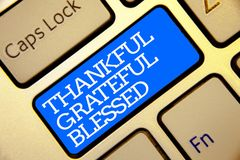 Writing note showing Thankful Grateful Blessed. Business photo showcasing Appreciation gratitude good mood attitude Golden color c. Omputer keyboard blue button royalty free stock image