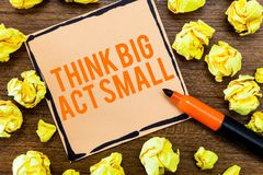 Writing note showing Think Big Act Small. Business photo showcasing Great Ambitious Goals Take Little Steps one at a. Time stock image
