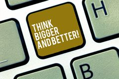 Writing note showing Think Bigger And Better. Business photo showcasing Have more great successful ideas Development. Keyboard Intention to create computer royalty free stock photography