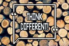 Writing note showing Think Different. Business photo showcasing Rethink Change on vision Acquire New Ideas Innovate Wooden. Background vintage wood wild message royalty free stock photos