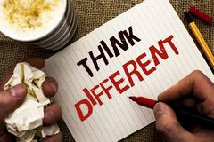 Writing note showing Think Different. Business photo showcasing Rethink Change on vision Acquire New Ideas Innovate written by Ma. N Holding Marker Notebook Book stock images