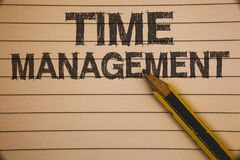 Writing note showing Time Management. Business photo showcasing Schedule Planned for Job Efficiency Meeting Deadlines Ideas conce. Pts on old beige notebook royalty free stock photo