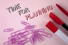 Writing note showing  Time For Planning. Business photo showcasing Start of a project Making decisions Organizing schedule written. Plain Pink background Pen Stock Image