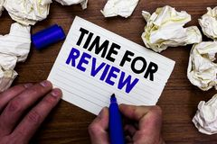 Writing note showing Time For Review. Business photo showcasing Evaluation Feedback Moment Performance Rate Assess Hand holding ma. Rker write words paper lob royalty free stock images