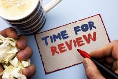 Writing note showing Time For Review. Business photo showcasing Evaluation Feedback Moment Performance Rate Assess written by Man. Cardboard Piece Holding stock image