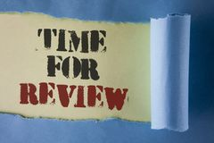 Writing note showing Time For Review. Business photo showcasing Giving Feedback Evaluation Rate job test or product Qualify writt. En under Tear Folded paper royalty free stock photography