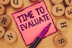 Writing note showing Time To Evaluate. Business photo showcasing moment rate used before products or service Give. Feedback royalty free stock photo