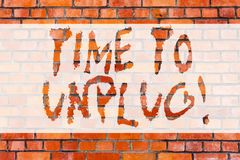 Writing note showing Time To Unplug. Business photo showcasing Relaxing giving up work disconnecting from everything. Brick Wall art like Graffiti motivational stock images