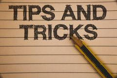 Writing note showing Tips And Tricks. Business photo showcasing Suggestions to Make things easier Helpful Advices Solutions Ideas. Concepts on old beige stock photo
