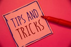 Writing note showing Tips And Tricks. Business photo showcasing Suggestions to Make things easier Helpful Advices Solutions Ideas. Concepts intentions on pink royalty free stock photo