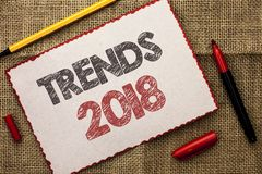 Writing note showing Trends 2018. Business photo showcasing Current Movement Latest Modern Branding New Concept Prediction writte. N Cardboard Piece the jute stock images
