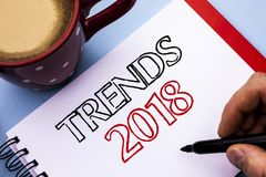 Writing note showing Trends 2018. Business photo showcasing Current Movement Latest Modern Branding New Concept Prediction writte. N Notebook Book Holding Pen royalty free stock photography