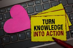 Writing note showing Turn Knowledge Into Action. Business photo showcasing Apply what you have learned Leadership. Strategies Red bordered yellow written paper stock photography