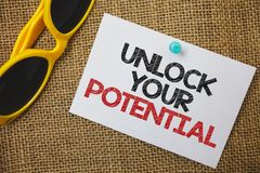 Writing note showing Unlock Your Potential. Business photo showcasing access your true skills and powers Believe in yourself Sung stock photography