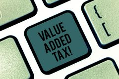 Writing note showing Value Added Tax. Business photo showcasing Amount of money added to cover production and. Distribution Keyboard key Intention to create stock photography