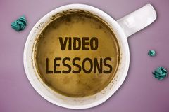 Writing note showing Video Lessons. Business photo showcasing Online Education material for a topic Viewing and learning.  stock images