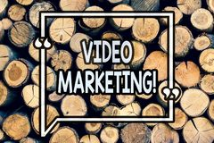 Writing note showing Video Marketing. Business photo showcasing Media Advertising Multimedia Promotion Digital Strategy Wooden. Background vintage wood wild stock photography