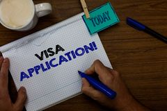 Writing note showing Visa Application. Business photo showcasing Form to ask permission travel or live in another country Hand hol. D pen coffee cup blue pen royalty free stock photo