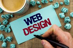 Writing note showing  Web Design. Business photo showcasing Web Layout Template Responsive Webpage Webdesign Sketch Navigation wri. Tten by Man Holding Pen Stock Photography