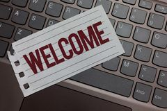 Writing note showing Welcome. Business photo showcasing Warm salutation acknowledgement for someone amiable loved thanked Keyboard. Colour grey paper keys stock images