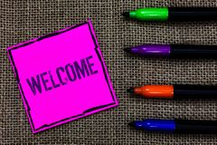 Writing note showing Welcome. Business photo showcasing Warm salutation acknowledgement for someone amiable loved thanked Marker p. Ens art pink paper nice mat royalty free stock images