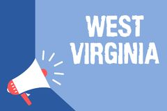 Writing note showing West Virginia. Business photo showcasing United States of America State Travel Tourism Trip Historical Megaph. One loudspeaker blue Royalty Free Stock Photo