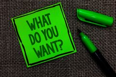 Writing note showing What Do You Want question. Business photo showcasing Tell me your desires requests demands ambition Black lin. Ed green sticky note with royalty free stock image