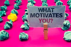 Writing note showing What Motivates You Question. Business photo showcasing Passion Drive Incentive Dream Aspiration Emerald pape. R balls yellow lump rosy floor stock images