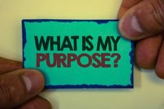 Writing note showing What Is My Purpose Question. Business photo showcasing Direction Importance Discernment Reflection Greyish b. Ackstage man hand retain blue stock image