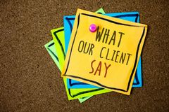 Writing note showing What Our Client Say. Business photo showcasing Customers Feedback or opinion about product service Papers be. Autiful colours messages Stock Photography