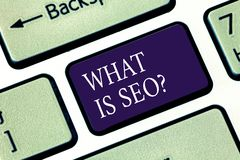 Writing note showing What Is Seo. Business photo showcasing Search Engine Keywording Marketing Online searching. Strategies Keyboard key Intention to create royalty free stock photo