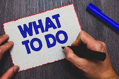Writing note showing What To Do. Business photo showcasing asking someone advice about next action is going to be made Man holding. Marker paper red borders stock photo