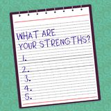 Writing note showing What Are Your Strengthsquestion. Business photo showcasing Tell us your best qualities skills Lined Spiral. Top Color Notepad photo on stock images