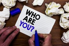 Writing note showing Who Are You question. Business photo showcasing Identify yourself description personal characteristics Hand h. Olding marker write words stock images