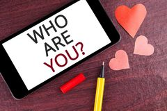 Writing note showing  Who Are You Question. Business photo showcasing Introduce or Identify Yourself Tell your Personal Story writ. Ten Mobile Phone Screen Royalty Free Stock Photo