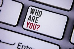 Writing note showing  Who Are You Question. Business photo showcasing Introduce or Identify Yourself Tell your Personal Story writ. Ten white keyboard key with Royalty Free Stock Photo