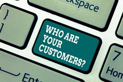 Writing note showing Who Are Your Customersquestion. Business photo showcasing Know your leads clients Business. Analysisagement Keyboard key Intention to stock image