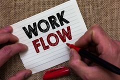 Writing note showing Work Flow. Business photo showcasing Continuity of a certain task to and from an office or employer Man's ha. Nd hold white paper with stock images