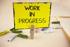 Writing note showing Work In Progress. Business photo showcasing People is working right know to deliver expected results written Royalty Free Stock Photos