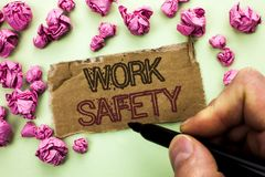 Writing note showing  Work Safety. Business photo showcasing Caution Security Regulations Protection Assurance Safeness written by. Man Holding Marker Tear Royalty Free Stock Image