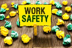 Writing note showing Work Safety. Business photo showcasing Policies and control in place according to government standard Clothes royalty free stock photography