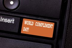 Writing note showing World Compliment Day. Business photo showcasing basic huanalysis need for recognition and. Appreciation day Keyboard key Intention to stock photography